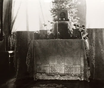 Empress Alexandra's white lace bedspread serving as an altar cloth.