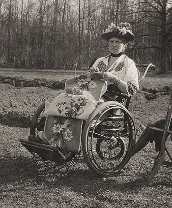 Empress Alexandra Feodorovna with her needlework during an outing in the Alexander Park.