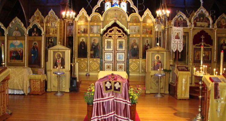 The old ROCOR cathedral of the Joy of All Who Sorrow in San Francisco with St John Maximovich's bishop's mantle on analogion stand in center of church