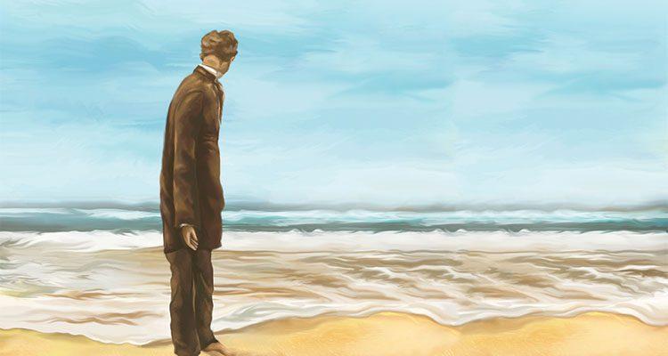 Man standing on an ocean beach