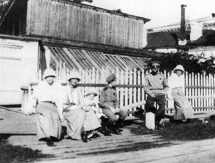 Nicholas II in Tobolsk sitting outside with his children